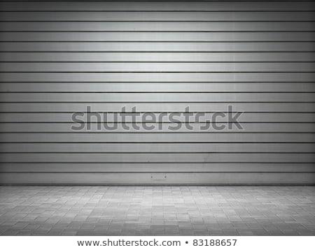 Illuminated grunge metallic roll up door Stock photo © H2O