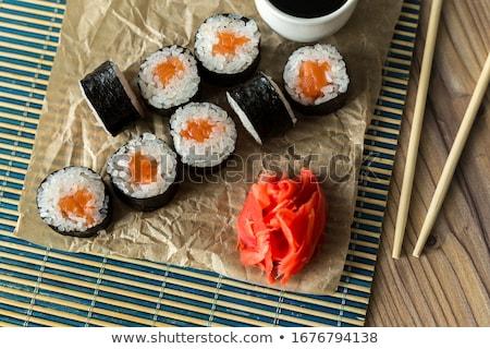 Stock photo: Japanese sushi. Tuna, sticks on bamboo napkin
