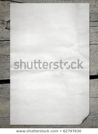 White paper pulled out from a notebook on a wood background  Stock photo © inxti