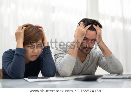 Couple calculating their budget Stock photo © photography33
