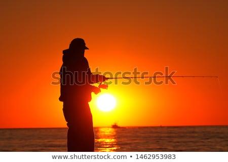 силуэта · рыбак · закат · удивительный · красочный · свет - Сток-фото © alex_davydoff