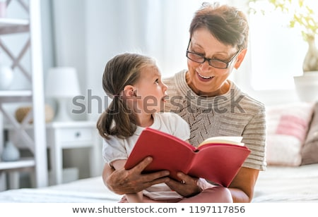 little girl reading a book with her granny Stock photo © photography33