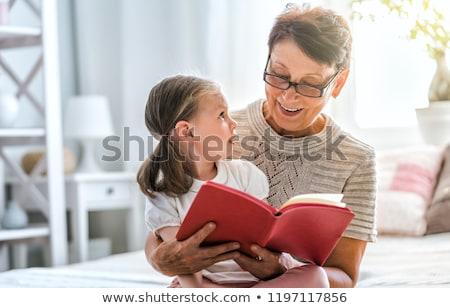 avó · little · girl · leitura · livro · feliz · juntos - foto stock © photography33