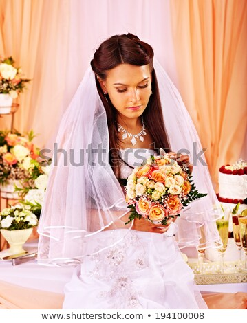 sad bride with champagne glass stock photo © massonforstock