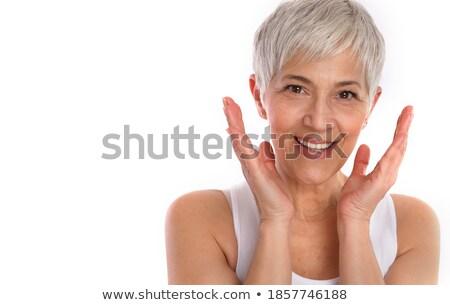 gracioso · senior · nu · mulher · olhando · câmera - foto stock © pressmaster
