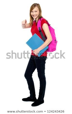 Modny liceum dziewczyna wskazując portret Zdjęcia stock © stockyimages