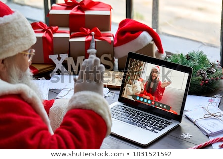christmas party girl with santa claus hat stock photo © carlodapino