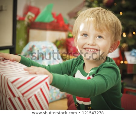 Baby and Young Boy Enjoying Christmas Morning Near The Tree Stock photo © feverpitch