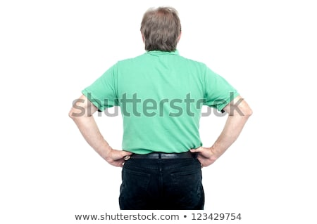 back pose of elderly guy with hands on his waist stock photo © stockyimages