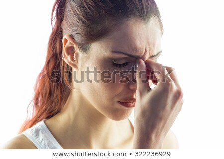 Woman experiencing a headache against a white background Stock photo © wavebreak_media