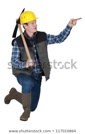 Tradesman holding a pickaxe and pointing his finger Stock photo © photography33