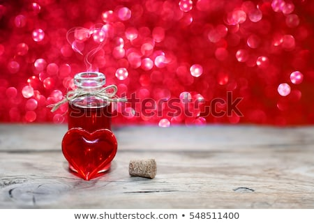 Bottle with red hearts- Love potion Stock photo © shawlinmohd