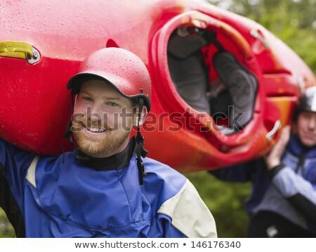 Homem canoa velho transportado fora Foto stock © ArenaCreative