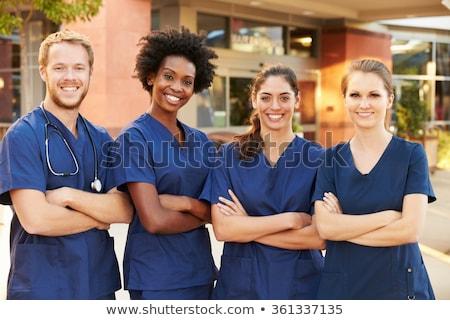 retrato · hermosa · morena · enfermera · aislado · negro - foto stock © arenacreative
