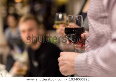 Man holding wineglass and woman Stock photo © zzve