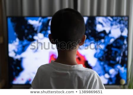 Fiatal srác néz tv konyha ül képernyő Stock fotó © soupstock