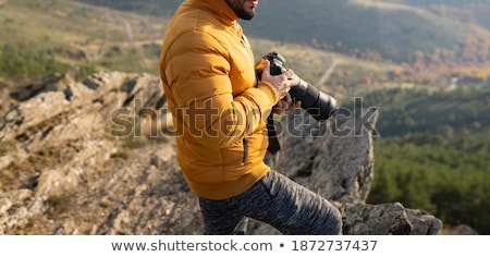 man hand with hand taking photo of tree in meadow stock photo © taden