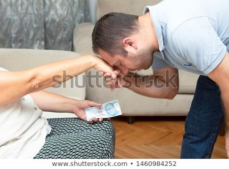 Young man kissing a beautiful woman stock photo © Kor
