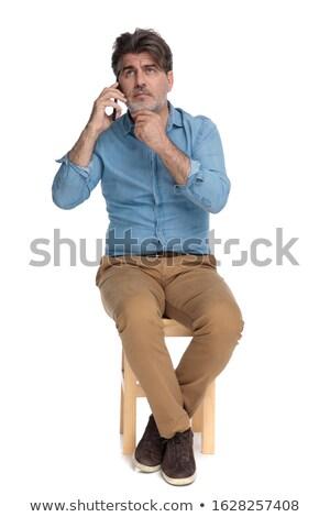 Sorridere vecchio uomo d'affari mento mano Foto d'archivio © feedough