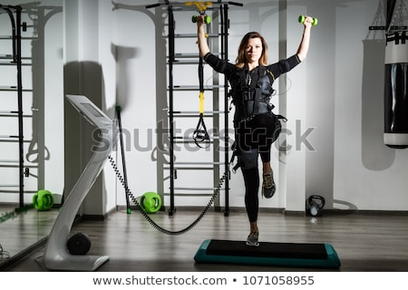 Young woman in Electro Muscular Stimulation EMS exercise training costume  Stock photo © Nejron