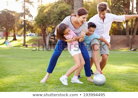 anya · gyerekek · játszik · futball · kert · ősz - stock fotó © monkey_business
