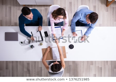 businesswoman - high angle smile stock photo © dgilder