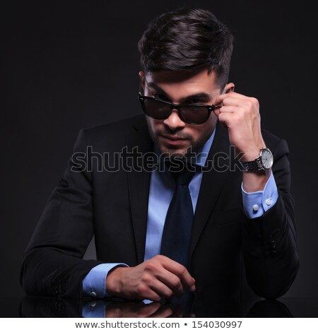 male model in suit and tie taking off his sunglasses  Stock photo © feedough