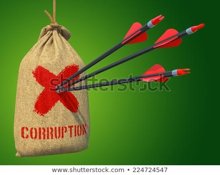 corruption   arrows hit in red target stock photo © tashatuvango