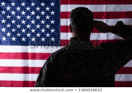 Rear view of male army soldier saluting Stock photo © stockyimages
