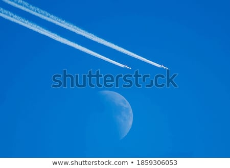 Sky,  moon, trace of the aircraft. Stock photo © Ralko