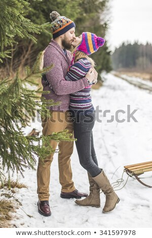 Young peaople are kissing in winter forest stock photo © Kor