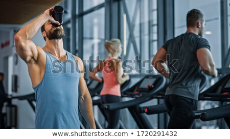 portrait of young man jogging stock photo © andreypopov