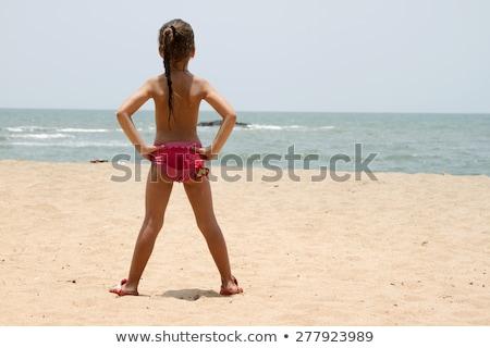 Beautiful Little Girl Standing On The Sandy Beach India Goa Stock fotó © mcherevan