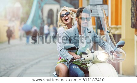 Portrait of a beautiful couple on scooter  Stock photo © deandrobot
