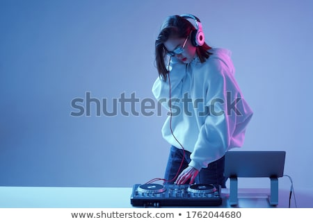 beautiful blonde dj girl on decks   the party stock photo © master1305