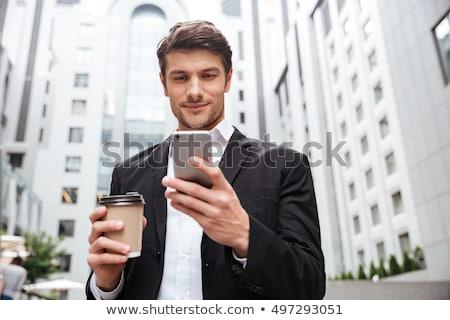 zakenman · buitenshuis · glimlachend · glazen · gebouw · gebouw - stockfoto © deandrobot