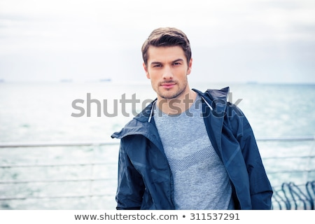 man in sports wear looking at the sea outdoors stock photo © deandrobot
