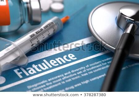 prisão · de · ventre · médico · foco · diagnóstico · pílulas · seringa - foto stock © tashatuvango