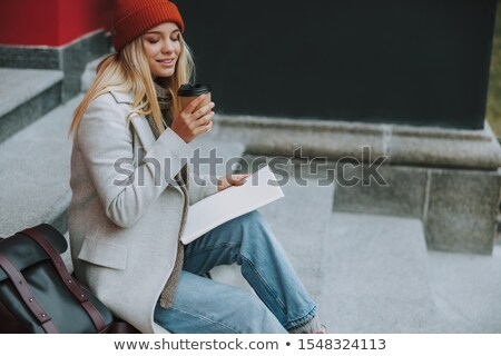 Grinning woman on stairs drinking coffee Stock photo © dash
