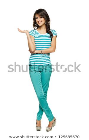 Smiling attractive young woman standing with legs crossed  Stock photo © deandrobot