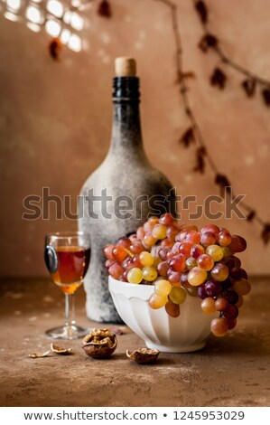 bunch of grapes and dusty bottle of wine Stock photo © olykaynen