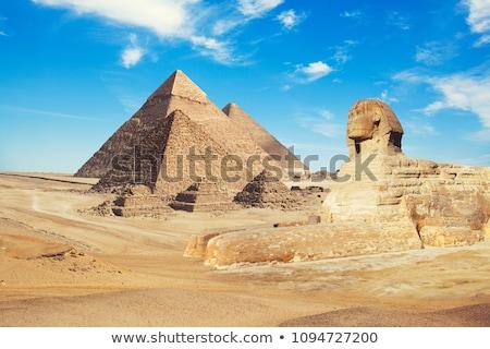 Foto stock: Antigo · pirâmides · estilizado · pôr · do · sol · paisagem · chuva