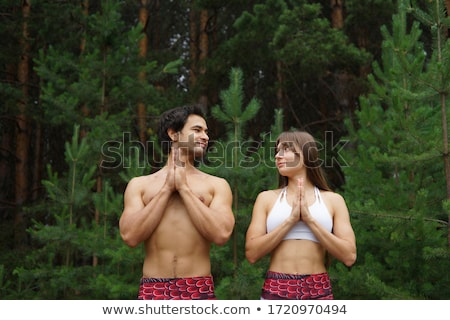 Two young women and man practicing acro yoga Stock photo © deandrobot