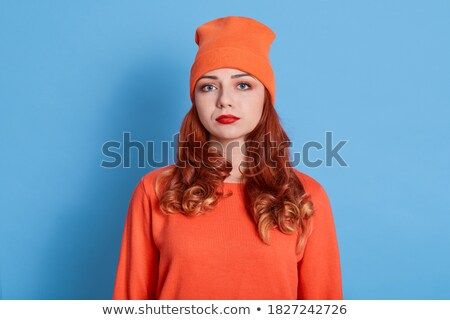 Sadness - moody portrait of a beautiful young redhead girl. Stock photo © lithian