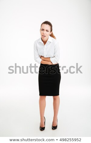 Full length portrait of a stressed businesswoman having stomach pain Stock photo © deandrobot