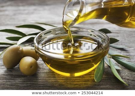 Aceite de oliva alto vidrio taza hojas petróleo Foto stock © Digifoodstock