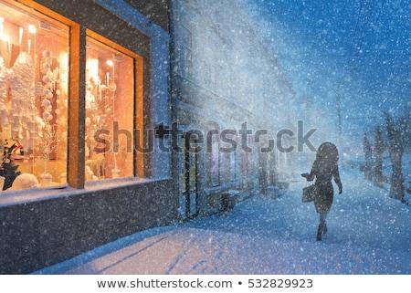 nő · karácsony · ablakok · fény · utca · piros - stock fotó © Karpenkovdenis