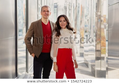 Senior in red sweater and business suit smiles Stock photo © ozgur