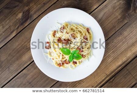 Italiano macarrão branco prato parmesão gema Foto stock © Yatsenko