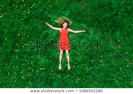 Pretty woman lying down. Stock photo © iofoto